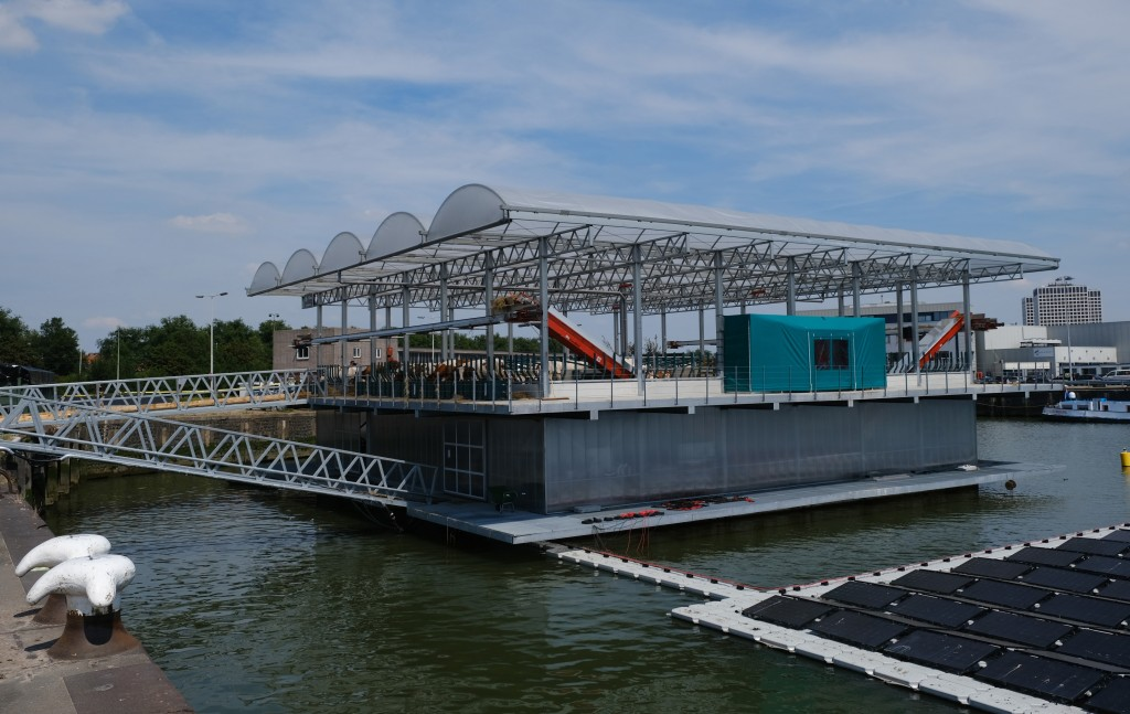 In this photo taken Monday, June 24, 2019, a futuristic three-storey floating farm is moored in Rotterdam harbour, Netherlands, where is is ideally pl...