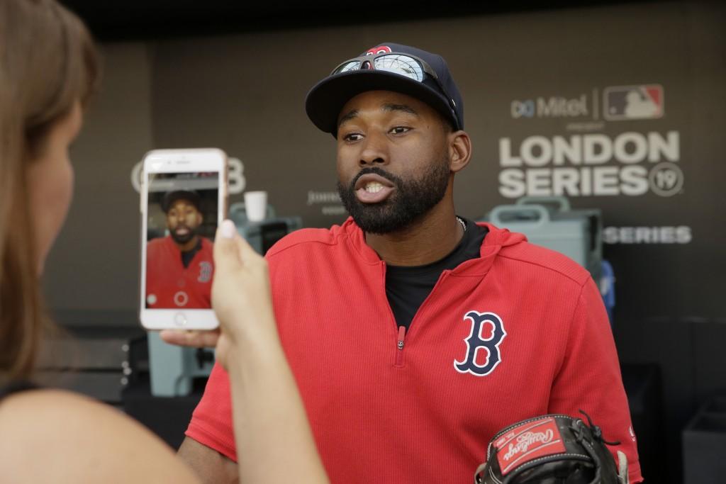 Boston Red Sox's Jackie Bradley Jr. talks after batting practice in London, Friday, June 28, 2019. Major League Baseball will make its European debut
