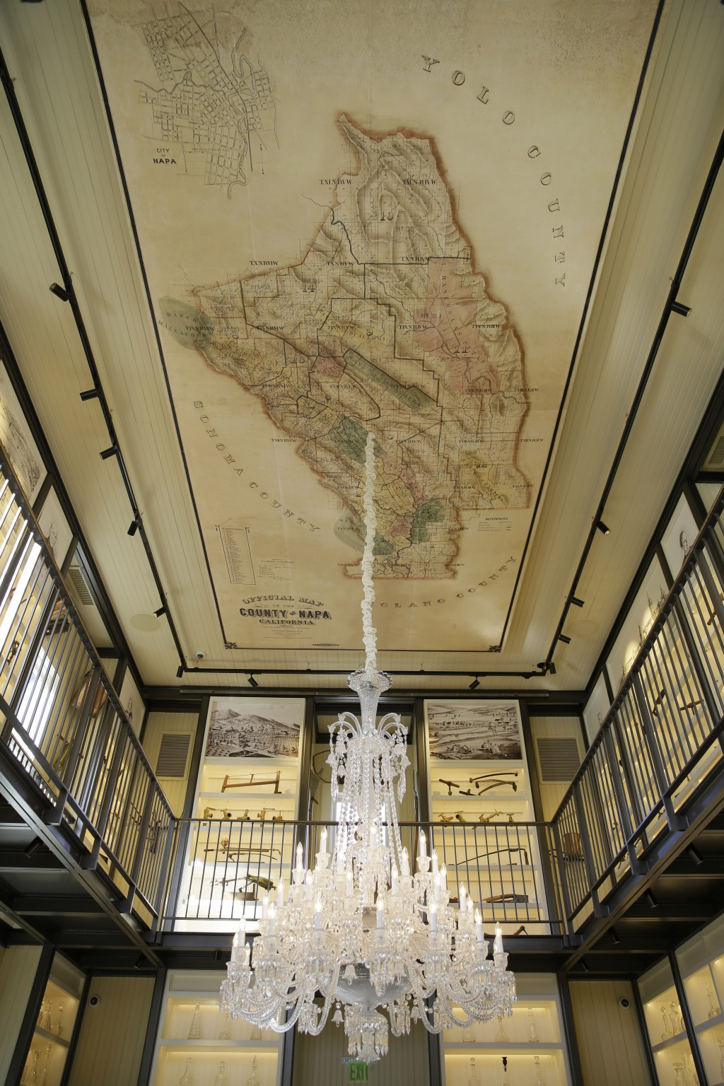 In this photo taken Wednesday, June 5, 2019, a 48-light Baccarat crystal chandelier and a reproduction of an 1895 map of Napa County on canvas hang fr...