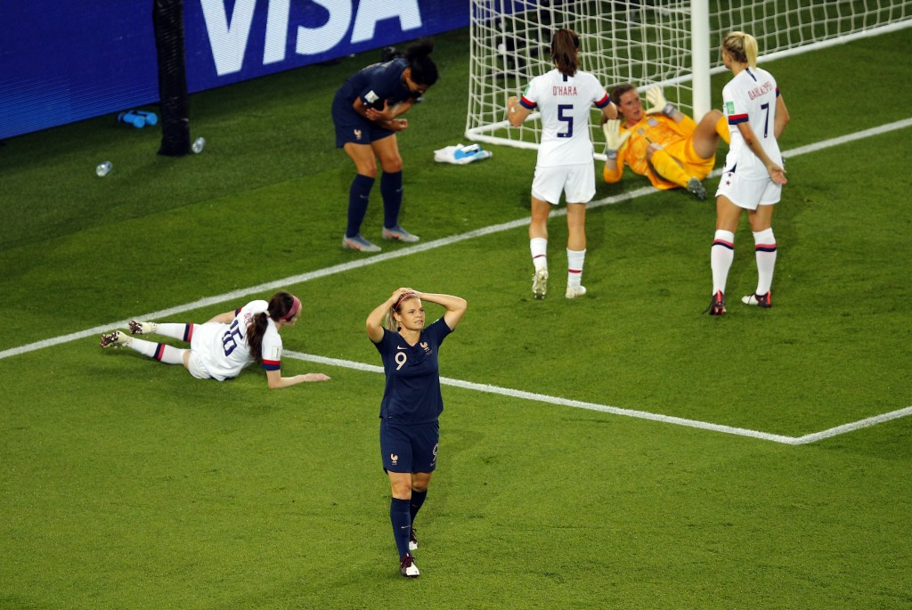 France's Eugenie Le Sommer, front, reacts after missing a chance to score during the Women's World Cup quarterfinal soccer match between France and th...