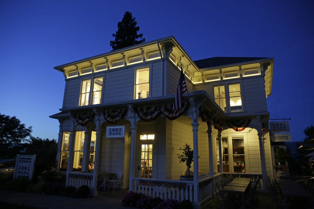 In this photo taken Wednesday, June 5, 2019, dusk falls on 1881 Napa in Oakville, Calif. 1881 Napa, a wine history museum and tasting salon, opened th...