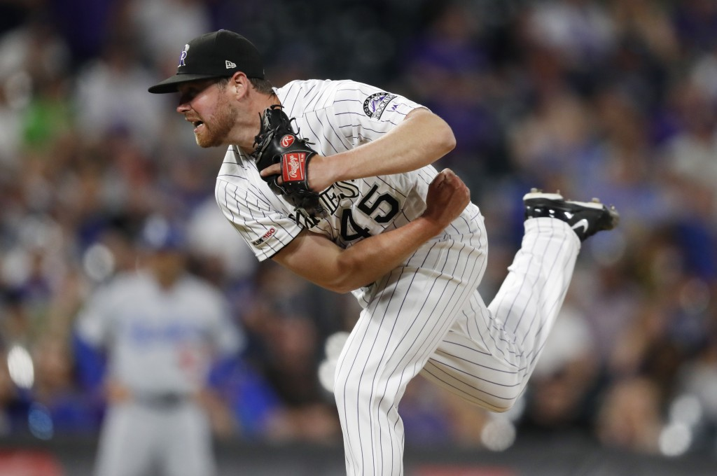 Colorado Rockies relief pitcher Scott Oberg works against the Los Angeles Dodgers during the ninth inning of a baseball game Friday, June 28, 2019, in...