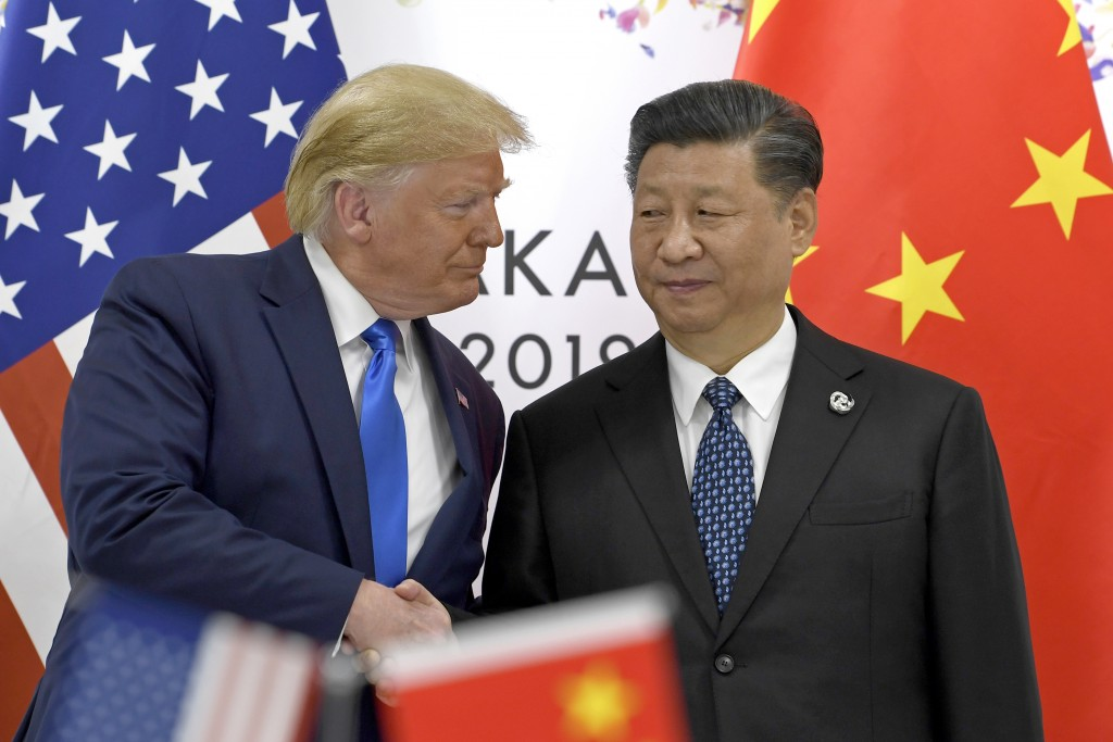 President Donald Trump, left, shakes hands with Chinese President Xi Jinping during a meeting on the sidelines of the G-20 summit in Osaka, Japan, Sat...