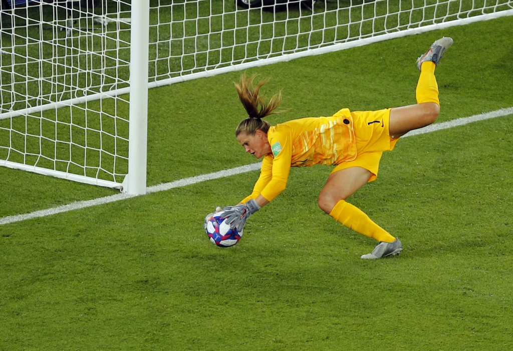 United States goalkeeper Alyssa Naeher makes a save during the Women's World Cup quarterfinal soccer match between France and the United States at the...
