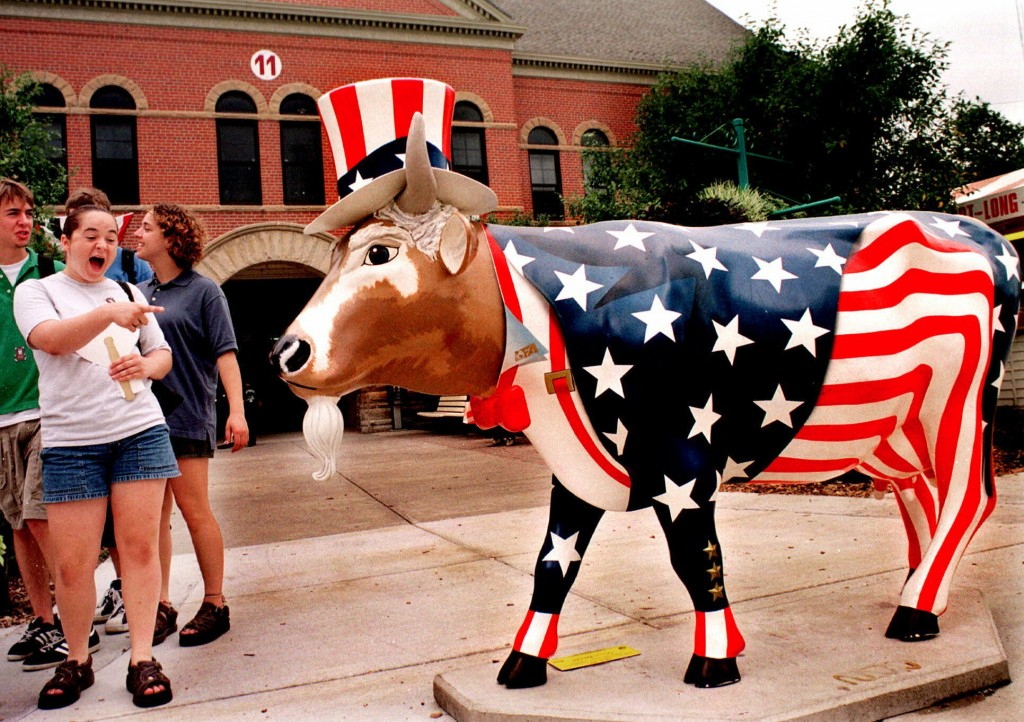 """FILE - In this Aug. 13, 1999 file photo, fairgoers enjoy """"Uncle Sam,"""" one of several Cows on Parade being exhibited during the 147th Illinois State Fa..."""