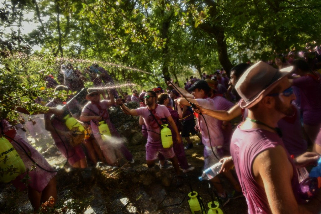 People take part in a wine battle, in the small village of Haro, northern Spain, Saturday, June 29, 2019. Hundreds of revelers participate in this fam...