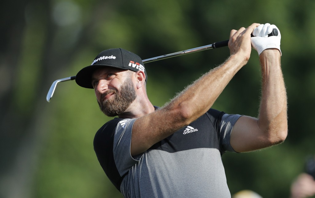 Dustin Johnson drives on the 15th tee during the second round of the Rocket Mortgage Classic golf tournament, Friday, June 28, 2019, in Detroit. (AP P...