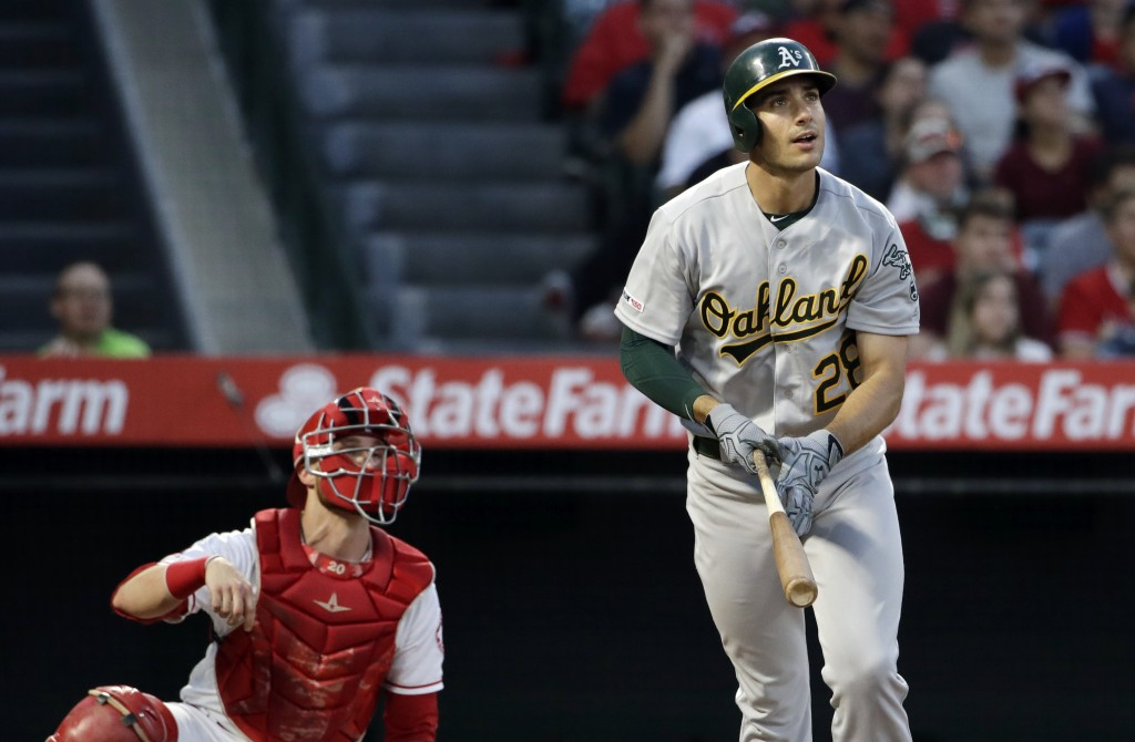 Oakland Athletics' Matt Olson watches his three-run home run against the Los Angeles Angels during the third inning of a baseball game Friday, June 28...