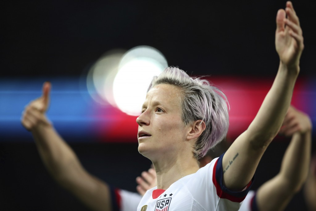 United States' Megan Rapinoe, center, celebrates after scoring her side's second goal during the Women's World Cup quarterfinal soccer match between F...