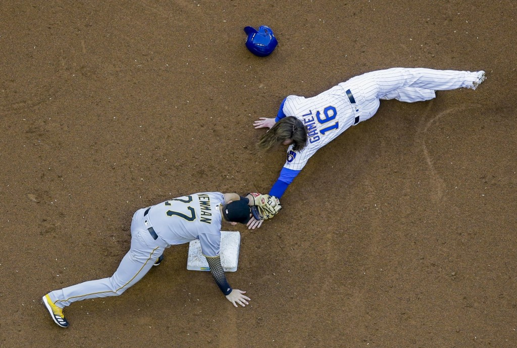 Pittsburgh Pirates' Kevin Newman tags out Milwaukee Brewers' Ben Gamel as he is caught stealing second during the second inning of a baseball game Fri...