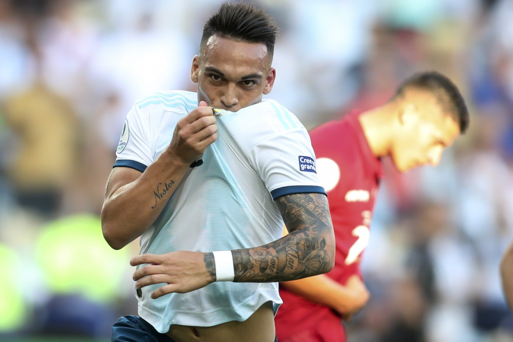 Argentina's Lautaro Martinez celebrates scoring his side's opening goal against Venezuela during a Copa America quarterfinal soccer match at the Marac...