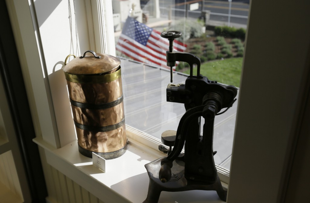 In this photo taken Wednesday, June 5, 2019, an old bottle corker and sprayer are seen in a window at 1881 Napa in Oakville, Calif. 1881 Napa, a wine ...