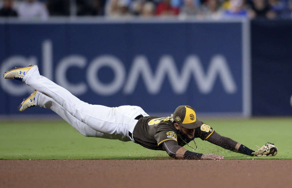 San Diego Padres shortstop Fernando Tatis Jr. dives for a ground ball single hit by St. Louis Cardinals' Michael Wacha during the fourth inning of a b...