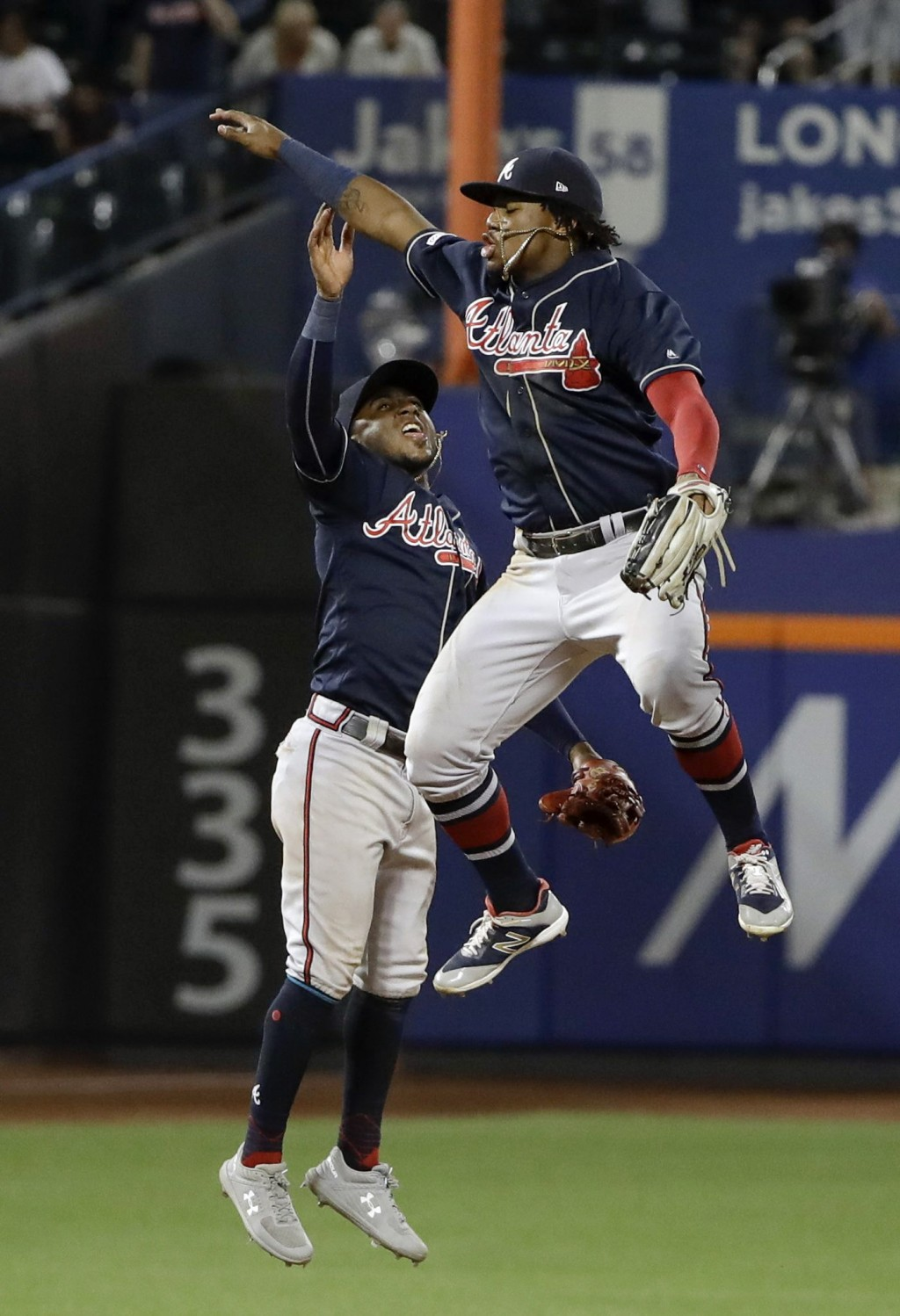 Atlanta Braves' Ozzie Albies, left, celebrates with Ronald Acuna Jr. after a baseball game against the New York Mets, Friday, June 28, 2019, in New Yo...