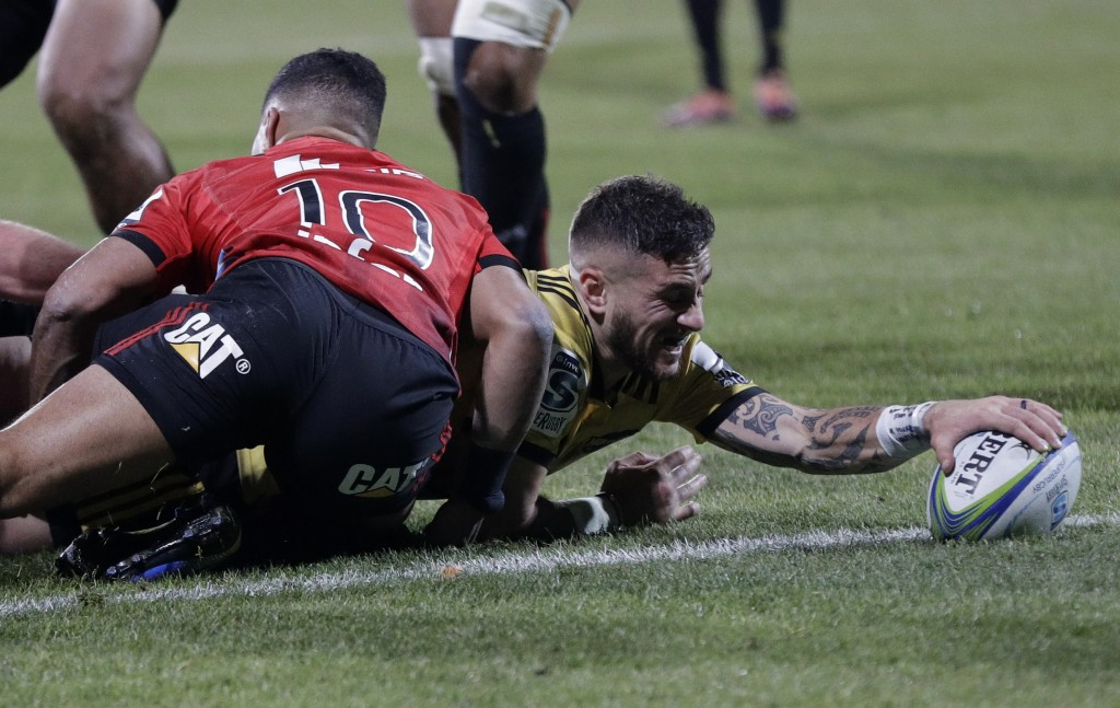 Hurricanes TJ Perenara scores a try during the Super Rugby semifinal between the Crusaders and the Hurricanes in Christchurch, New Zealand, Saturday, ...