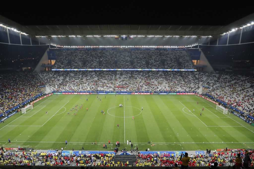 Players of Colombia warm up prior to a Copa America quarterfinal soccer match against Chile at the Arena Corinthians in Sao Paulo, Brazil, Friday, Jun...