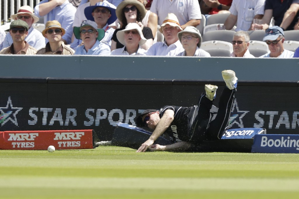 New Zealand's Martin Guptill stops a four during the Cricket World Cup match between New Zealand and Australia at Lord's Cricket Ground in London, Eng