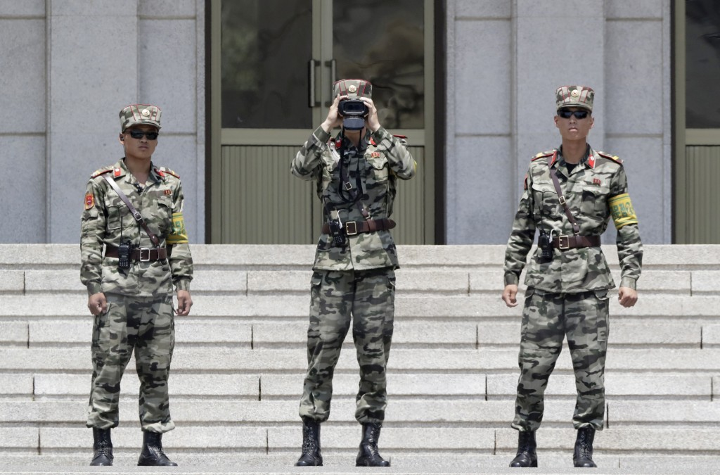 In this June 12, 2019, photo, North Korean soldiers look at the South side, seen during a press tour at the Panmunjom in the Demilitarized Zone (DMZ),...