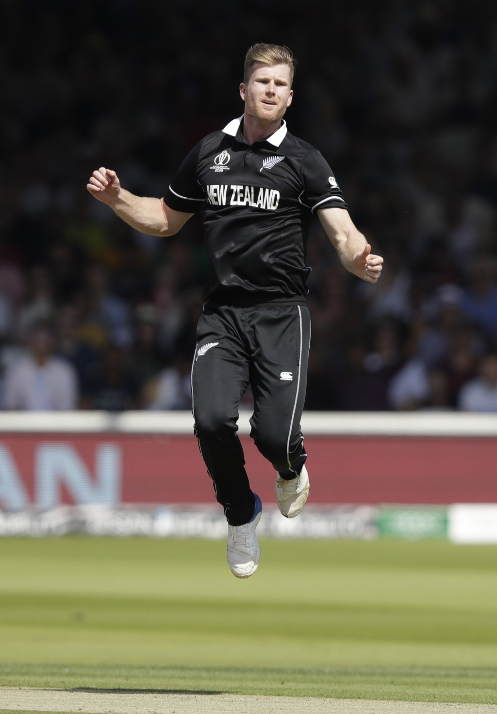 New Zealand's James Neesham reacts after almost taking the wicket of Australia's Usman Khawajaduring the Cricket World Cup match between New Zealand a...