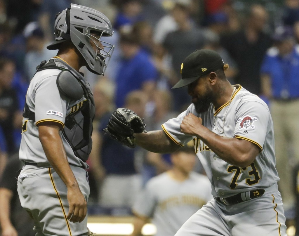 Pittsburgh Pirates' Felipe Vazquez celebrates with catcher Elias Diaz after a baseball game against the Milwaukee Brewers Friday, June 28, 2019, in Mi...