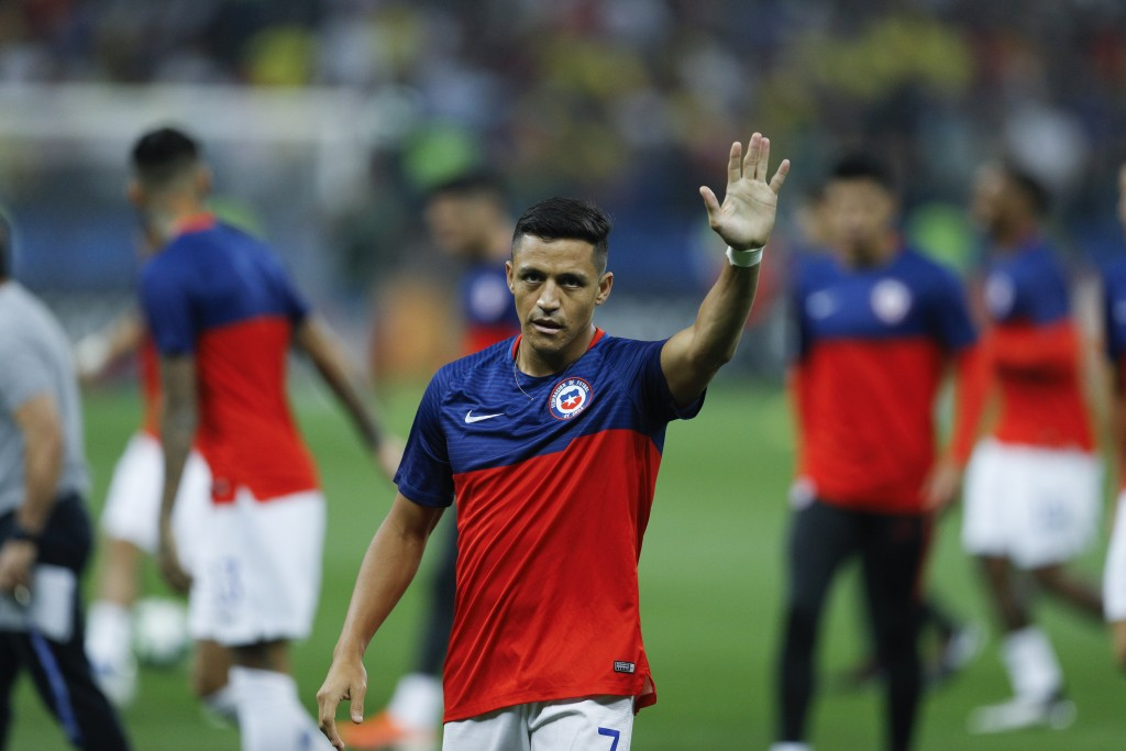 Chile's Alexis Sanchez waves to fans during the warm up of a Copa America quarterfinal soccer match between Colombia and Chile at the Arena Corinthian...