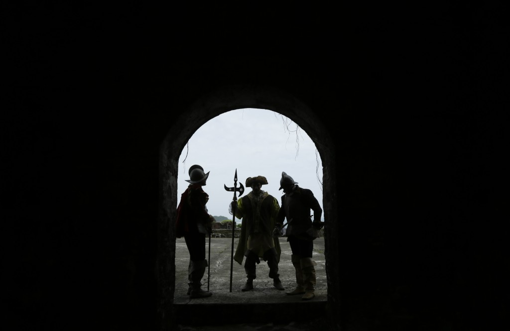 Men wearing Spanish conquistador costumes stand on a door frame of Fort San Lorenzo, on a promontory overlooking the mouth of the Chagres River, on Pa...