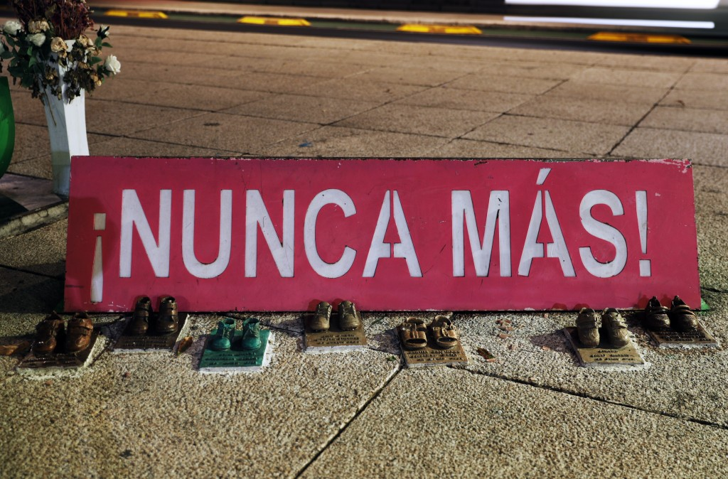 """This June 19, 2019 photo shows bronze replicas of children's shoes that make up part of the ABC """"anti-monument"""" outside the Mexican Social Security In..."""