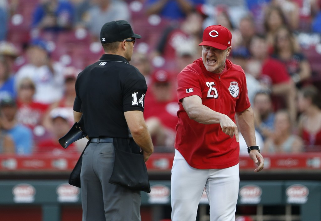 Cincinnati Reds manager David Bell (25) argues with home plate umpire Mark Wegner about whether Reds batter Jose Peraza was hit by a pitch during the ...