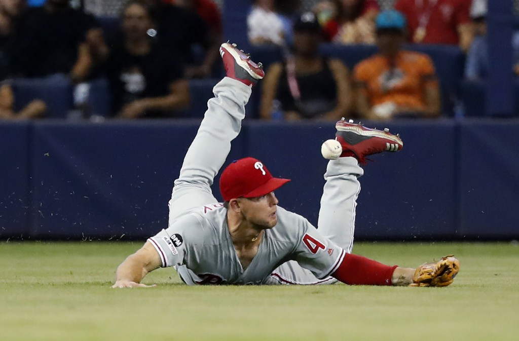 Philadelphia Phillies left fielder Scott Kingery is unable to catch a ball hit by Miami Marlins' Neil Walker for an RBI single during the seventh inni...