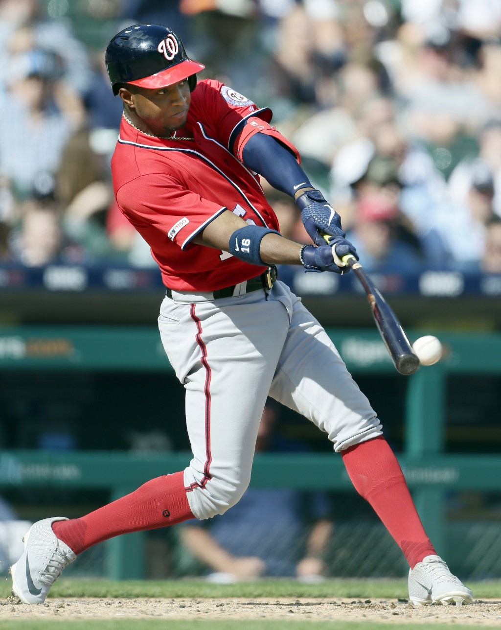 Washington Nationals' Victor Robles singles to drive in Brian Dozier during the fourth inning of a baseball game against the Detroit Tigers, Saturday,...