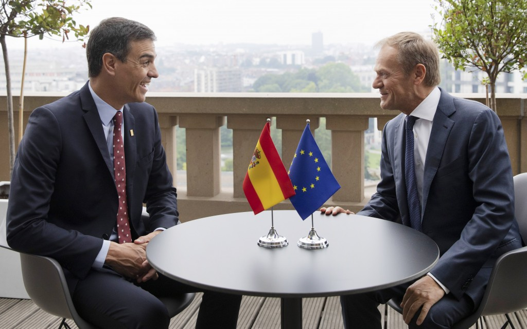 Spanish Prime Minister Pedro Sanchez, left, speaks with European Council President Donald Tusk during a meeting on the sidelines of an EU summit in Br...