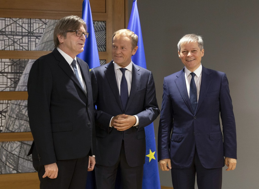 European Council President Donald Tusk, center, welcomes Renew Europe party members Guy Verhofstadt, left, and Daclan Ciolos, right, prior to a meetin...