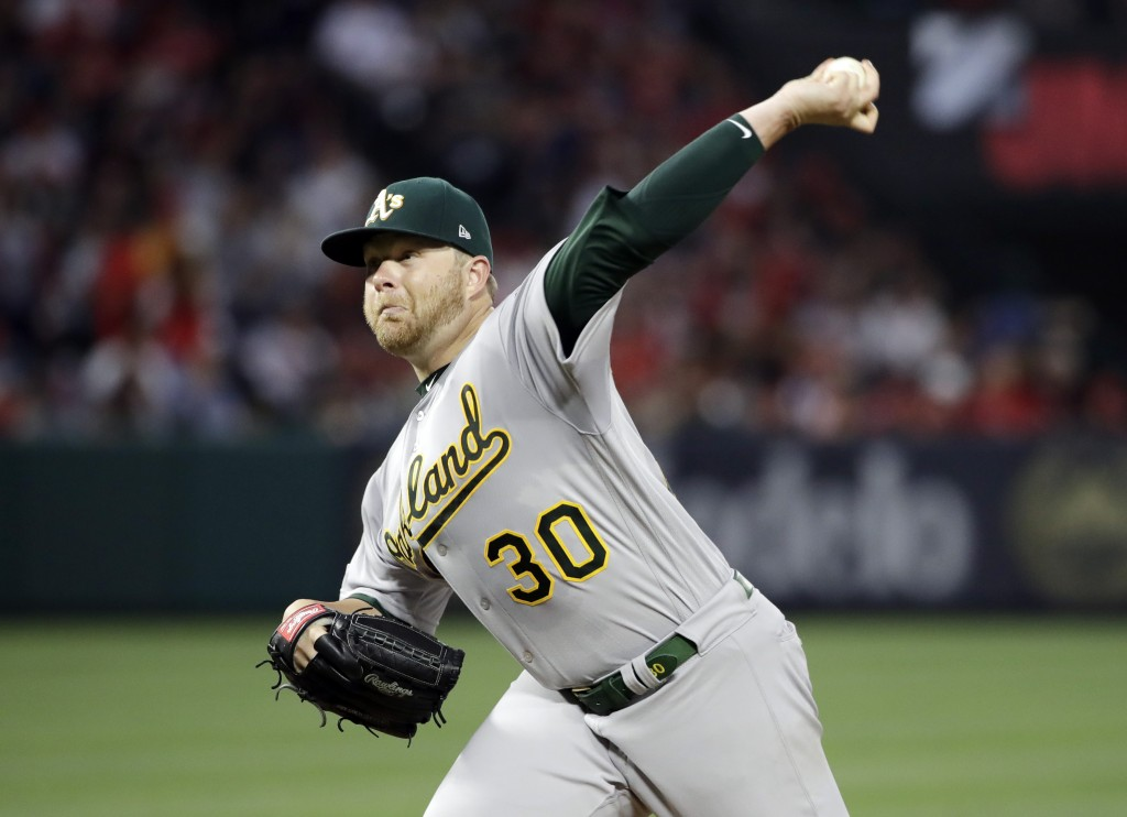Oakland Athletics starting pitcher Brett Anderson throws to s Los Angeles Angels batter during the fifth inning of a baseball game Saturday, June 29, ...