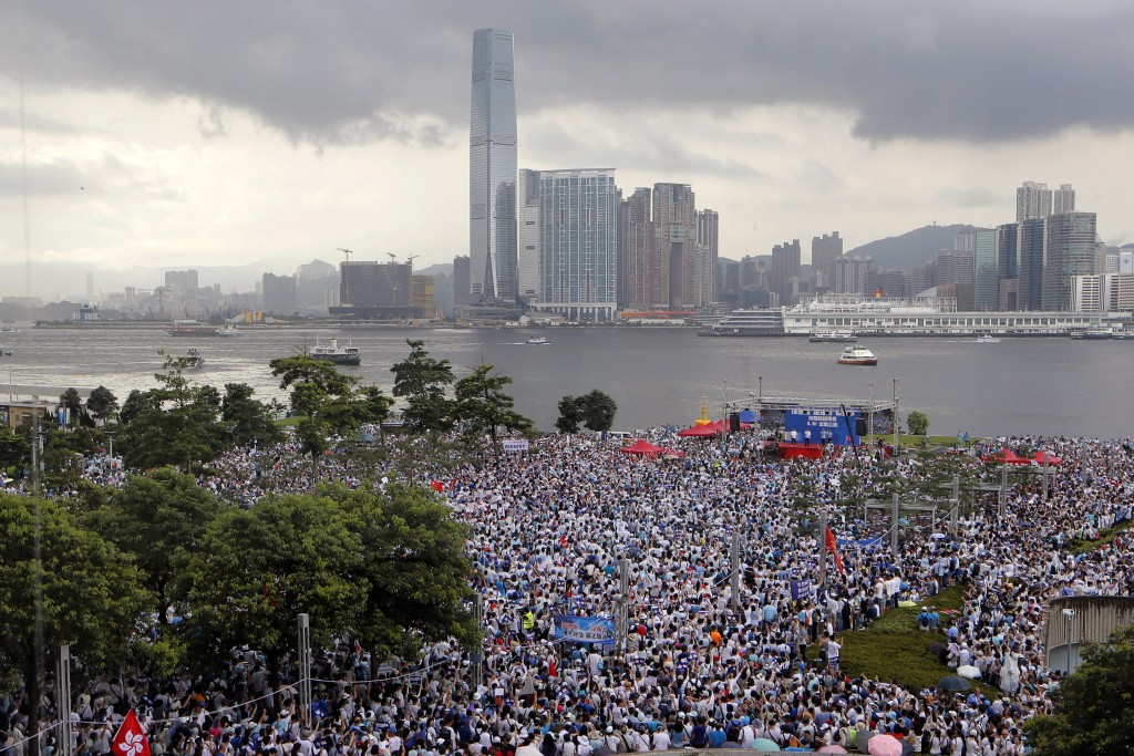 """Pro-China's supporters hold Chinese flags and placards read """"We support police"""" during a rally outside Legislative Council Complex in Hong Kong, Sunda..."""