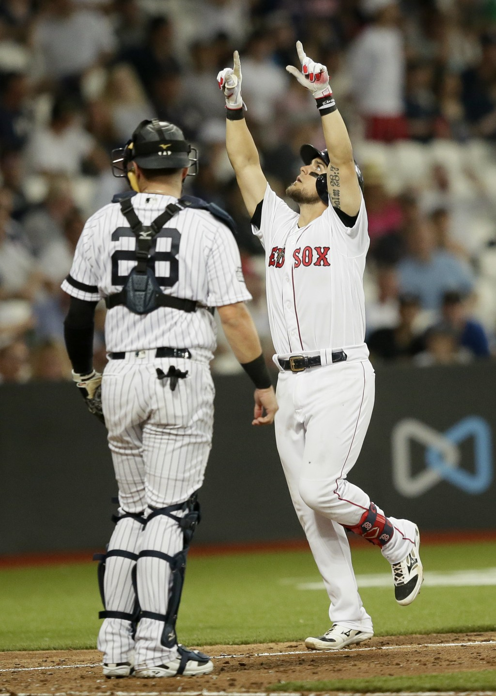 Boston Red Sox's Michael Chavis celebrates his three-run home run against the New York Yankees during the seventh inning of a baseball game, Saturday,...