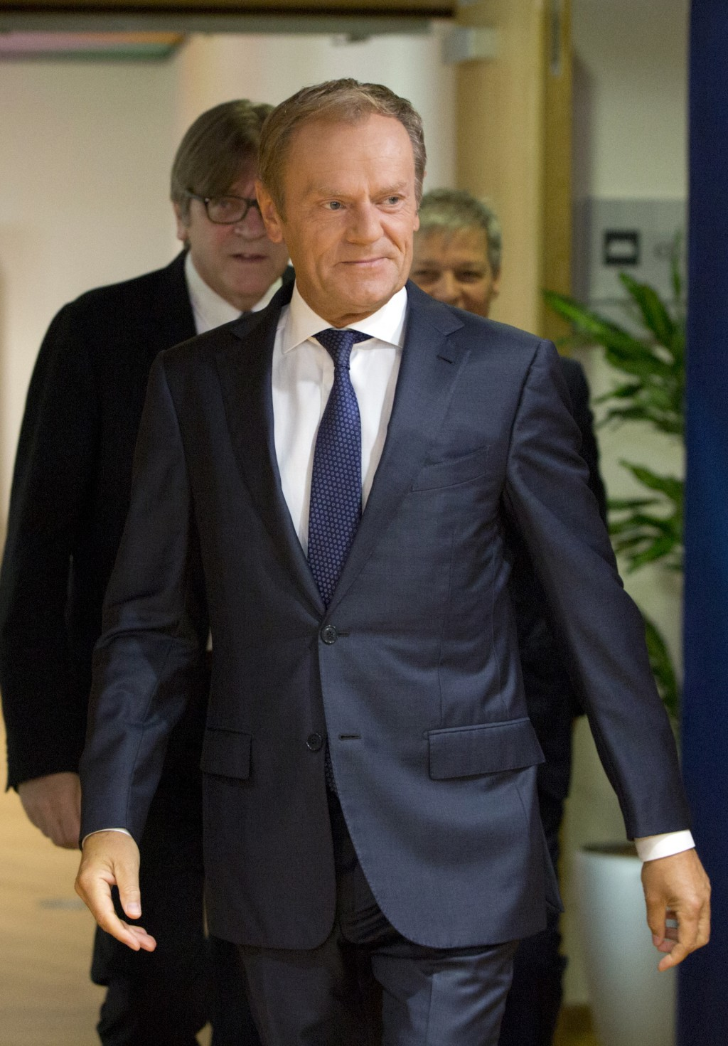 European Council President Donald Tusk, center, arrives with Renew Europe party members Guy Verhofstadt, left, and Daclan Ciolos, right, prior to a me...
