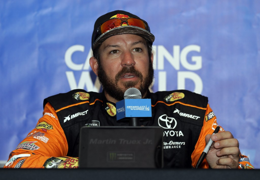 Martin Truex Jr., talks to media during a practice for the NASCAR Sprint Cup Series auto race at Chicagoland Speedway in Joliet, Ill., Saturday, June ...