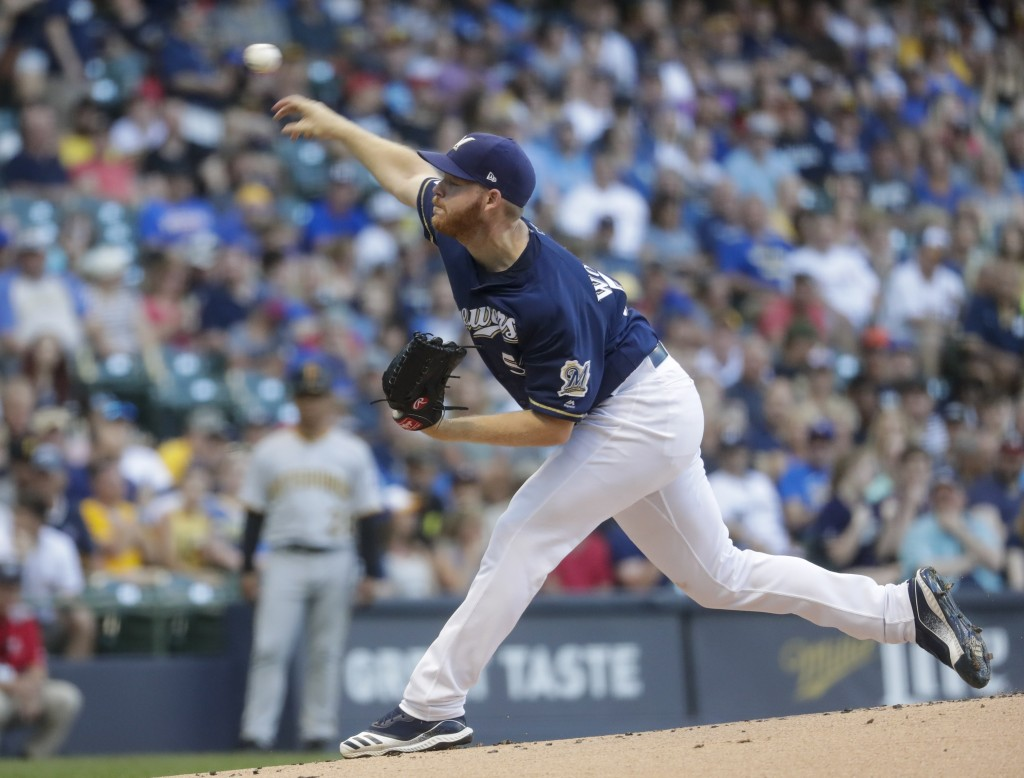 Milwaukee Brewers starting pitcher Brandon Woodruff throws during the first inning of a baseball game against the Pittsburgh Pirates Saturday, June 29...