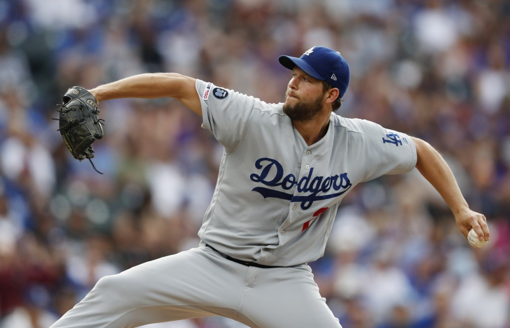 Los Angeles Dodgers starting pitcher Clayton Kershaw works against the Colorado Rockies in the first inning of a baseball game Saturday, June 29, 2019...