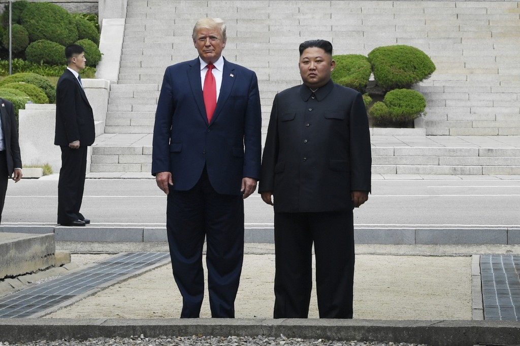 President Donald Trump and North Korean leader Kim Jong Un stand on the North Korean side in the Demilitarized Zone, Sunday, June 30, 2019 at Panmunjo...