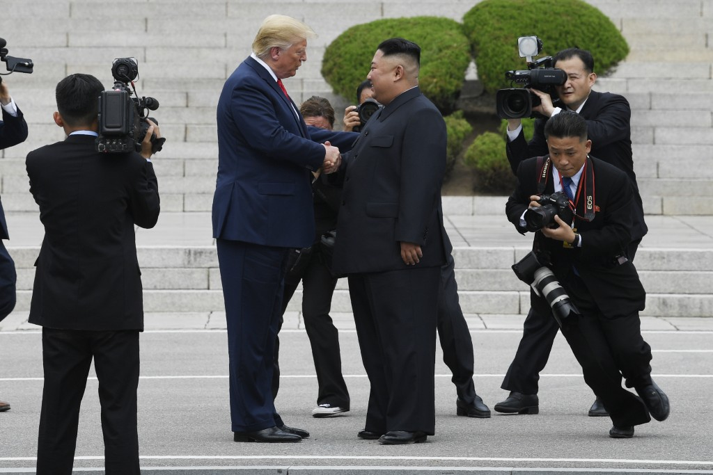 President Donald Trump walks to the North Korean side of the border with North Korean leader Kim Jong Un at the border village of Panmunjom in the Dem...
