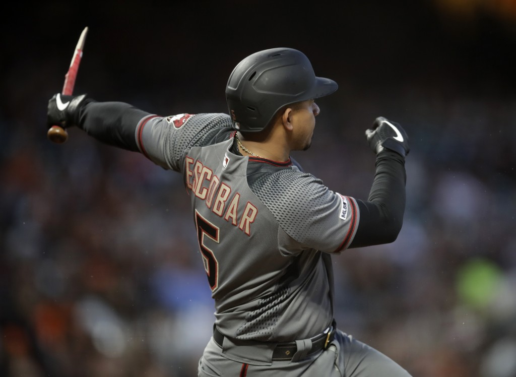 Arizona Diamondbacks' Eduardo Escobar breaks his bat after hitting a single off San Francisco Giants' Drew Pomeranz during the fifth inning of a baseb...