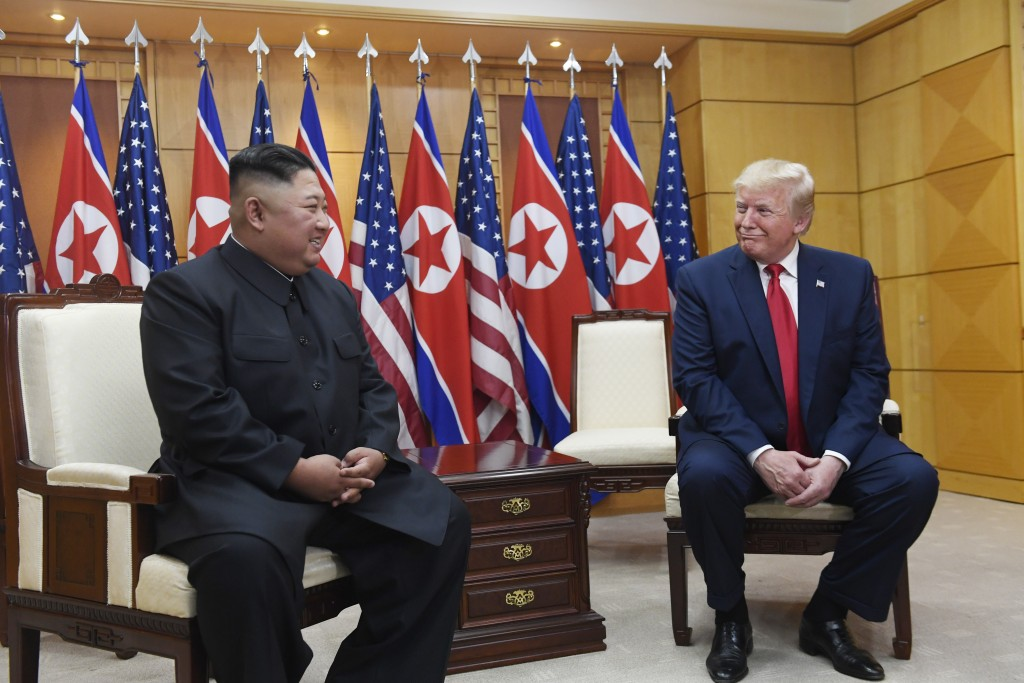 President Donald Trump meets with North Korean leader Kim Jong Un at the border village of Panmunjom in the Demilitarized Zone, South Korea, Sunday, J...