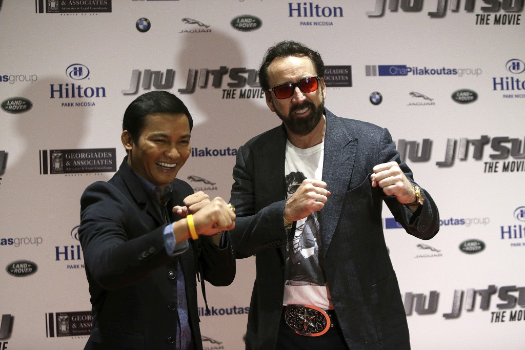 Academy award winning actor Nicolas Cage, right, and actor Jony Jaa pose for the media at a news conference for his new film Jiu Jitsu being filmed on...