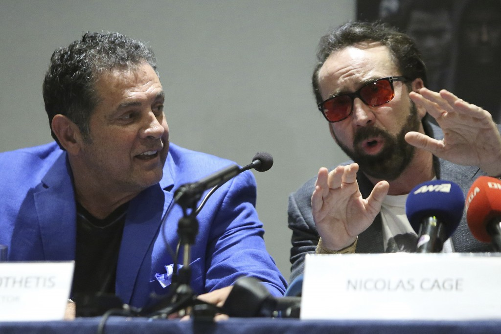 Academy award winning actor Nicolas Cage, right, and director Dimitri Logothetis speak at a news conference for his new film Jiu Jitsu being filmed on...