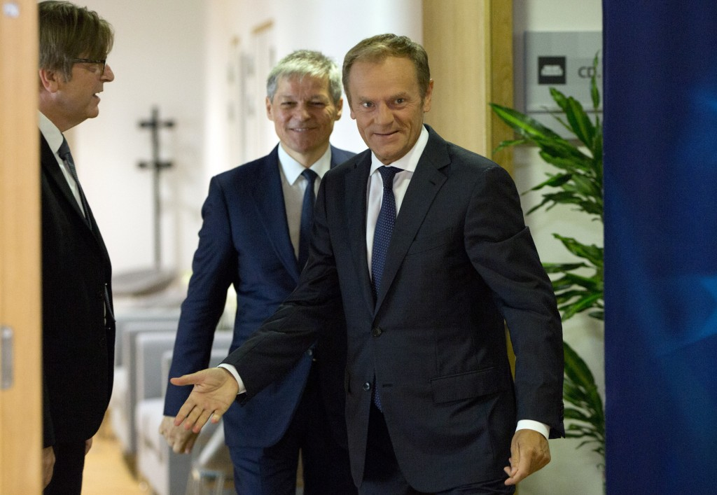 European Council President Donald Tusk, right, welcomes Renew Europe party members Guy Verhofstadt, left, and Daclan Ciolos, center, prior to a meetin...