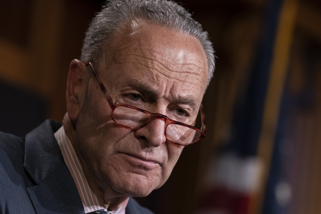 FILE - In this Tuesday, June 18, 2019 file photo, Senate Minority Leader Chuck Schumer, D-N.Y., talks to reporters at the Capitol in Washington. Schum...
