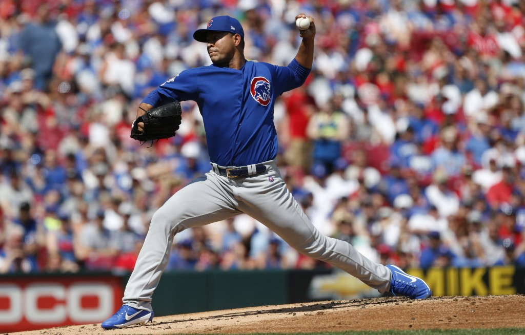 Chicago Cubs starting pitcher Jose Quintana throws against the Cincinnati Reds during the first inning of a baseball game, Saturday, June 29, 2019, in...