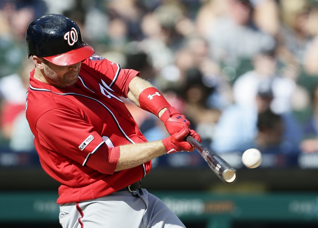 Washington Nationals' Brian Dozier doubles to drive in teammate Juan Soto against the Detroit Tigers during the fourth inning of a baseball game Satur...