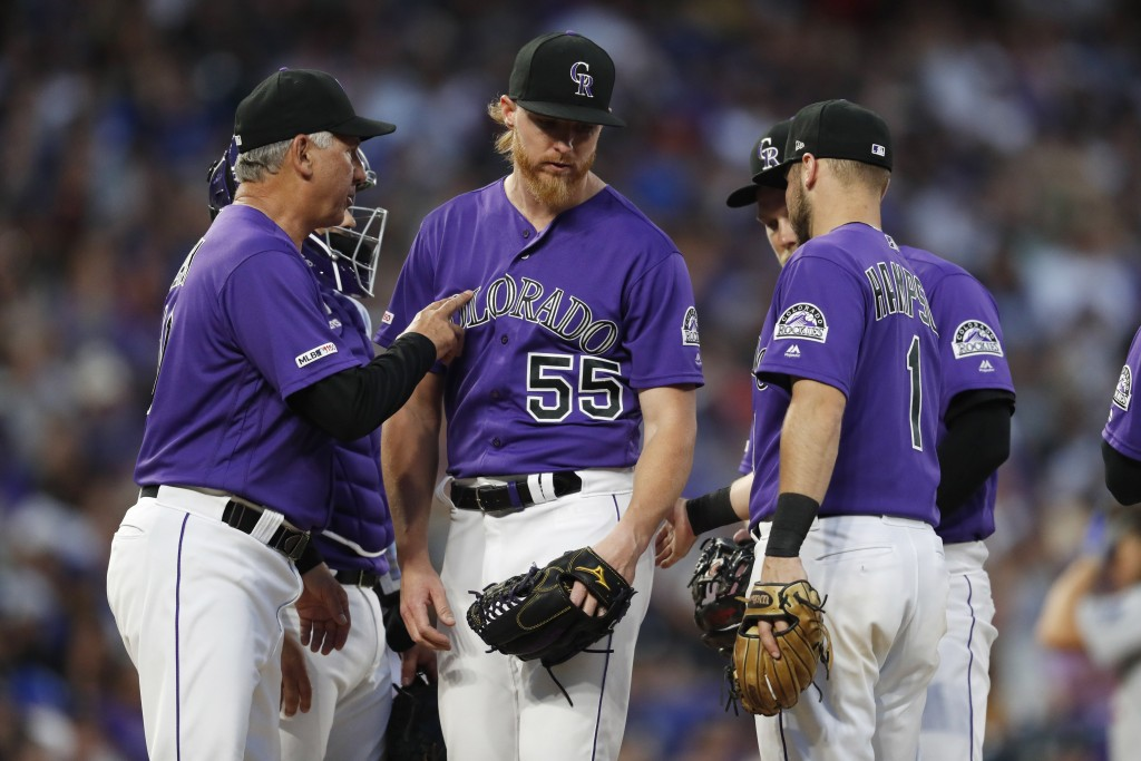 Colorado Rockies manager Bud Black, left, pulls starting pitcher Jon Gray (55) after Gray gave up a single to Los Angeles Dodgers' Alex Verdugo in the...